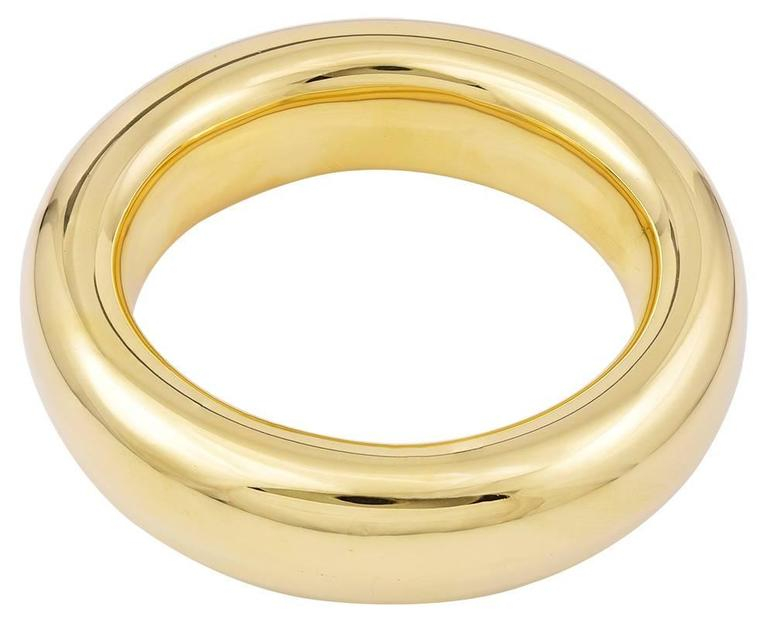 "Sculptural simplicity.  Big and beautiful ""donut"" oval bangle bracelet.  Made by Elsa Peretti c.1981for TIFFANY & CO.  Heavy gauge 18K yellow gold.  Effortlessly chic.  Feels and looks like liquid gold.  For a medium to large"