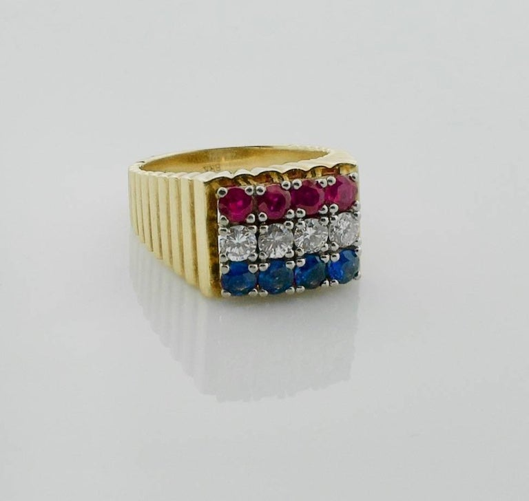 Red-White and Blue Diamond Sapphire and Ruby Ring in 18k  Four Round Brilliant Cut Diamonds weighing .50 carats approximately [GH VVS-VS] Eight Round Cut Rubies and Sapphires weighing 1.50 carats approximately [bright with no imperfections visible