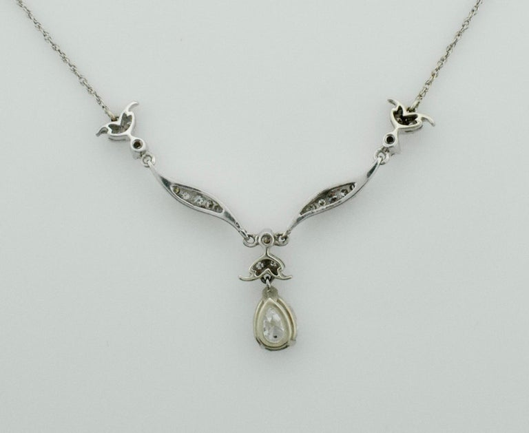 Diamond Dangling Diamond Pear Shape Necklace in Platinum on 14 Karat Chain In Excellent Condition For Sale In Wailea, HI