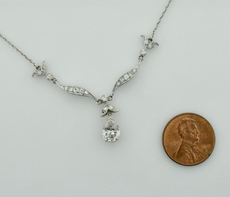 Women's or Men's Diamond Dangling Diamond Pear Shape Necklace in Platinum on 14 Karat Chain For Sale