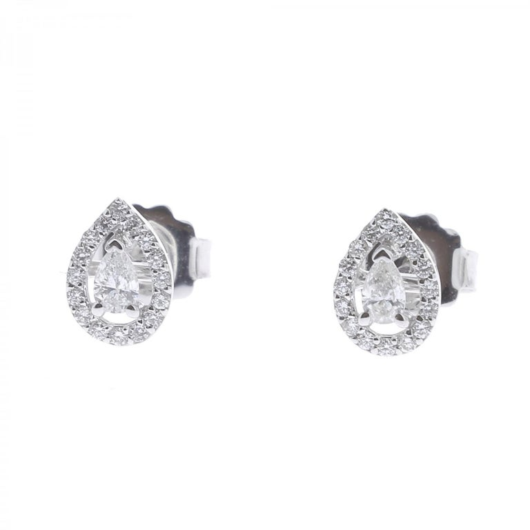 Pear-Shape Diamonds Earrings set with a halo of Round Diamonds weighing 0.22  carats, centered on a Marquise Diamond weighing 0.14 carats. Totally these Earrings weights 0.36 Carats. The Diamonds are GVS qualities. The Clip-on Earrigns are 18K White