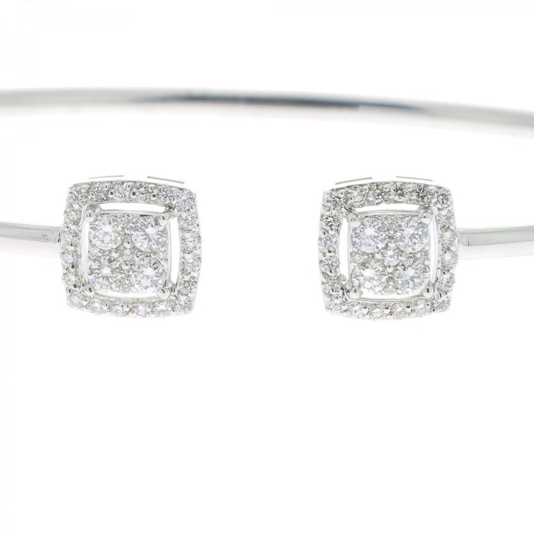 A wonderful Diamond Bangles Bracelet set with Round Diamonds weighing 0.61 Carats. The Diamonds are GVS quality. The Bangle Bracelet is 18K White Gold. The Diamond Bracelet weight 4.20 Grams. The Diameter of the Bracelet is 5.5 Cm/ 2.16 In.