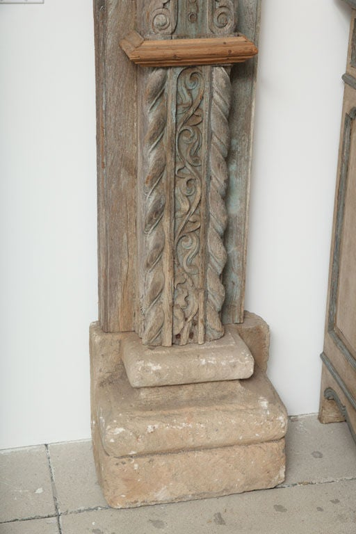 Carved Stone Base : Impressive pair of carved wooden columns with stone bases