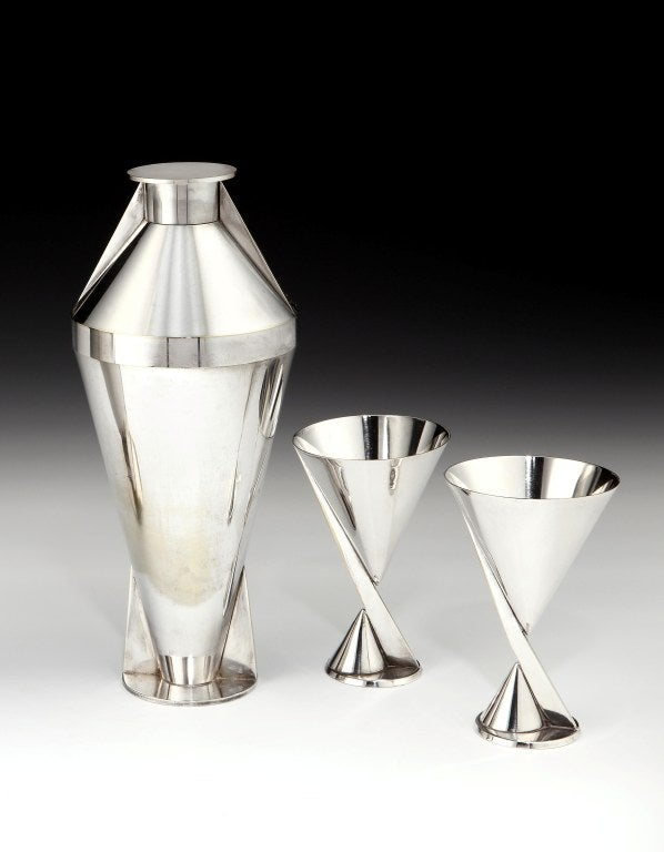 An incredibly rare and important Art Deco cocktail set comprising silver-plated Modernist cocktail shaker and a pair of goblets, each piece bearing maker's marks to the base, all French, circa 1928. <br /> <br /> Height of shaker: 10 inches (26