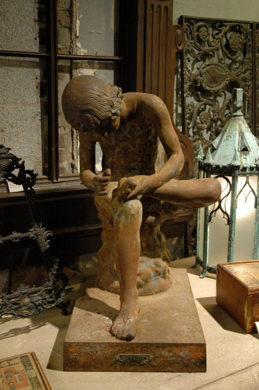 CAST IRON SPINARIO FIGURE<br /> 19th century Boy with Thorn, also called Fedele (Fedelino) or Spinario, is based on a Greco-Roman Hellenistic sculpture of a boy withdrawing a thorn from the sole of his foot, now in the Palazzo dei Conservatori,