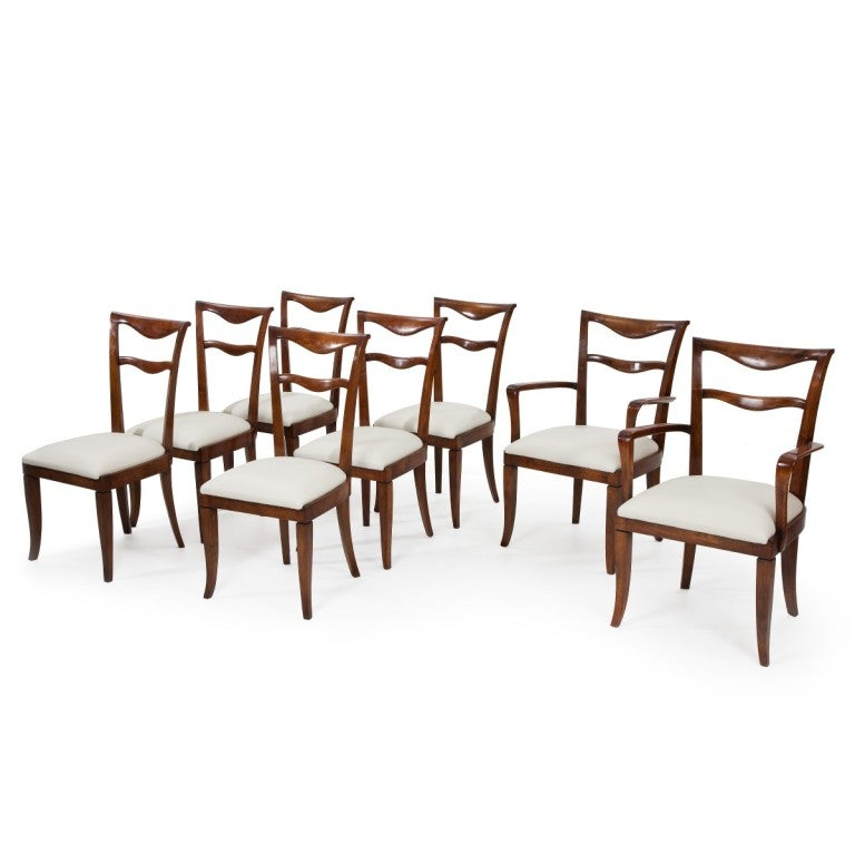 Set of six elegant figured walnut dining chairs and two carvers reupholstered in leather, by Maurizio Tempestini.