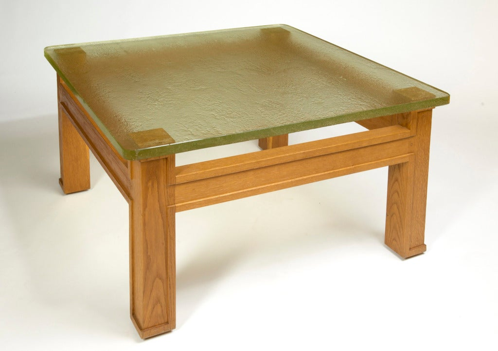 Jacques Adnet (1900-1984), attributed to, Superb large carved oak modernist table with beautiful sand-cast glass top. France, circa 1950. Dimensions: 37 x 37 x 20 H.