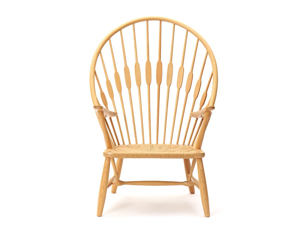 """An ash """"peacock"""" chair with rare ash arms and the original woven papercord seat."""