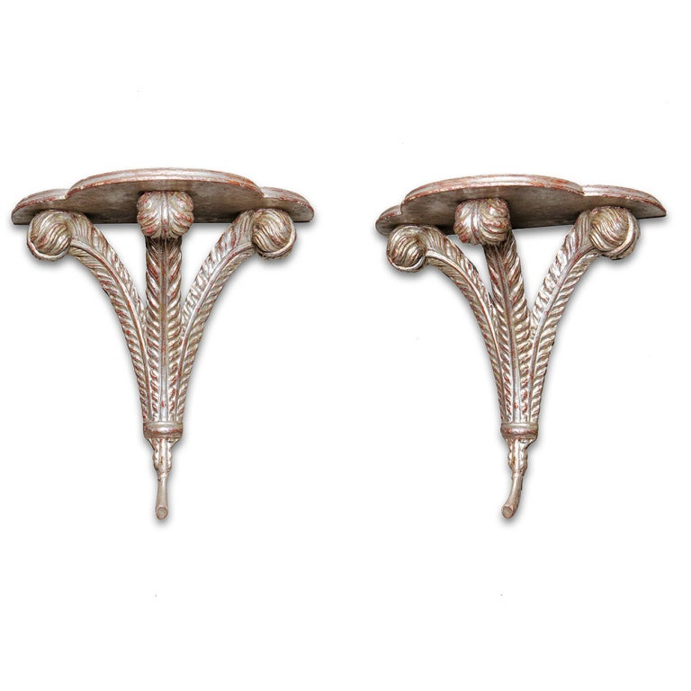 Pair of silver leaf Prince of Wales wall brackets.
