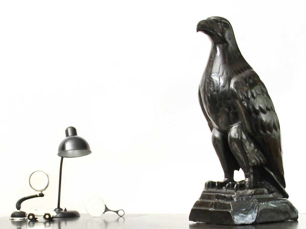 A white Eagle Gas Co. antique cast iron eagle sculpture.