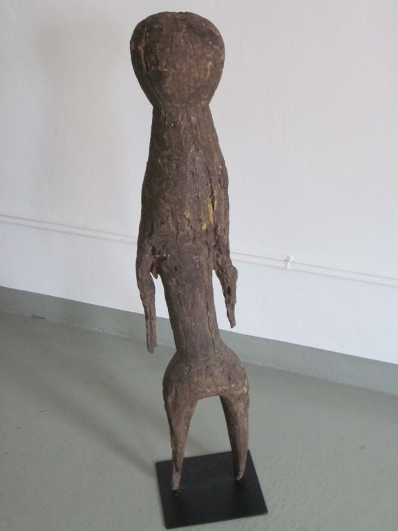 Elegant,Primitive carved wood sculpture representing the human figure from Togo, Africa.  A large, dramatic piece for a tribal art collection and special Brutalist presence.