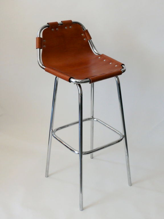Newly produced barstools in the style of Charlotte Perriand. Tubular frame and legs in chrome with rich brown leather seat and chrome rivet detail. Exact measurements of originals produced for Les Arcs ski lodge by Charlotte Perriand. Multiple