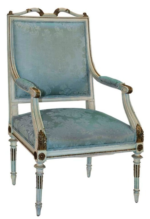 This beautiful French Empire chair crafted in the style of George Jacob has padded arms and cabriole legs with ornate gold carvings.
