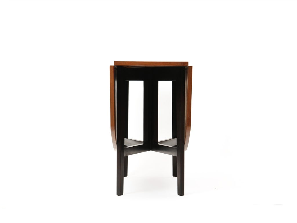 A mahogany drop-leaf table with ebonized gate-leg base. Measures: Console table depth of 16.5