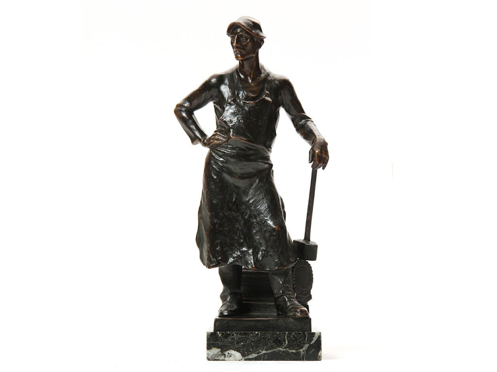 A bronze statue of a blacksmith on a marble base by Adolph Joseph Pohl. Made in Austria, circa 1920s.