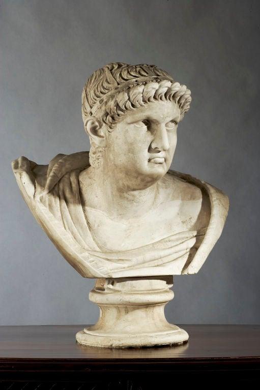 Plaster bust of Roman figure.