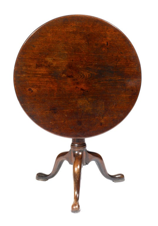 Late 18th century mahogany tilt top table, with bird cage support on plain tapering column raised on down-swept legs and pad feet.