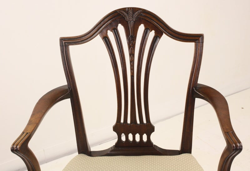 An 18th century mahogany armchair, carefully restored. Beautifully shaped arms and carved back. The mahogany has a warm glow and patina. Suitable as a desk or occasional chair. Arm height is 26