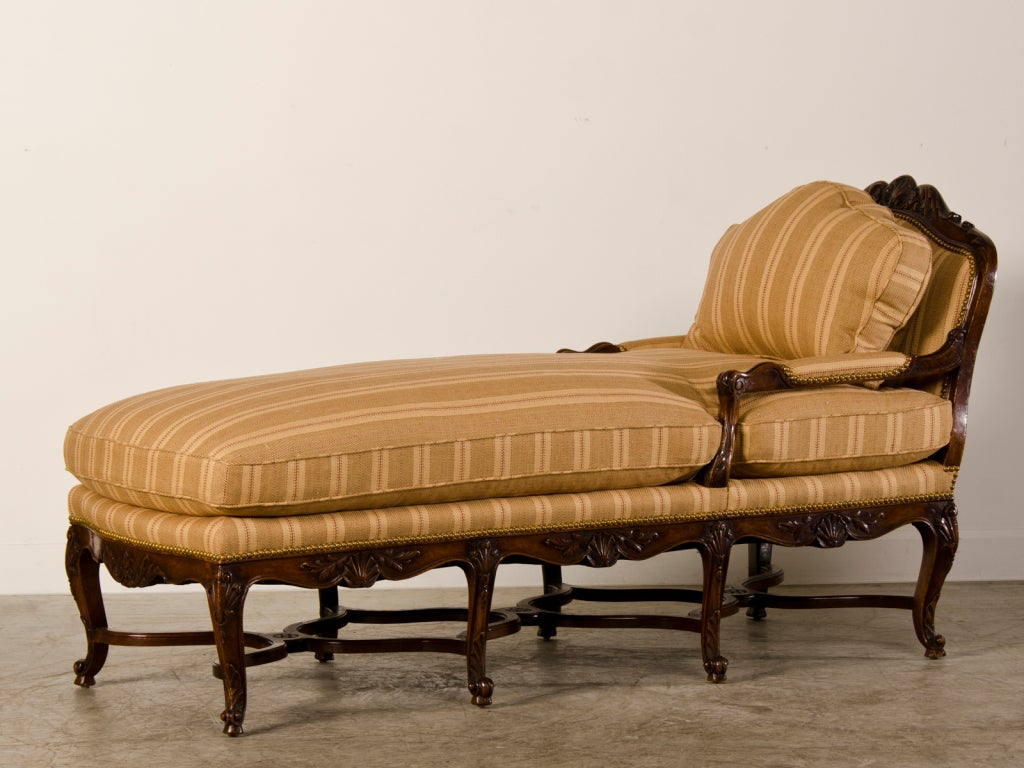 Antique french regence period carved walnut chaise longue for Antique wooden chaise lounge