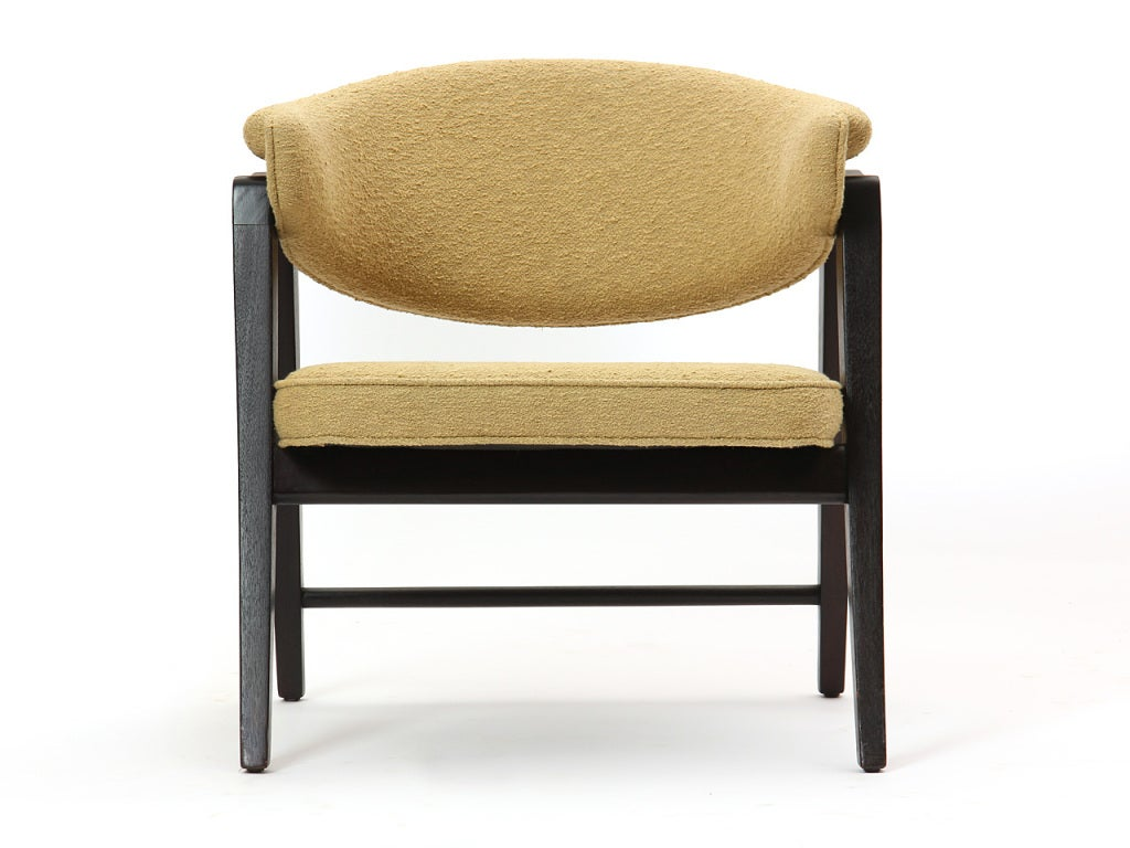 "An armchair with an ebonized mahogany ""A frame"" and the original mustard upholstered seat and back."