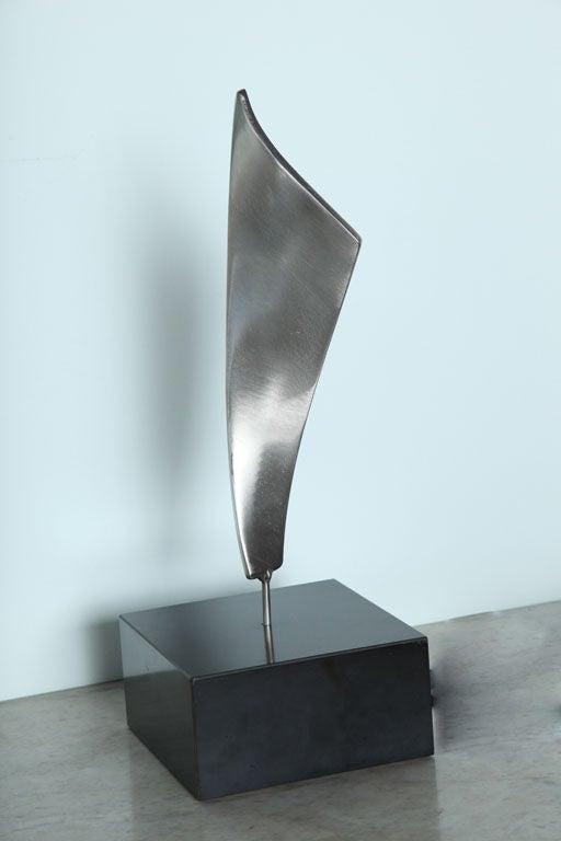 Kafka stainless steel sculpture on base. Signed kafka 1967.