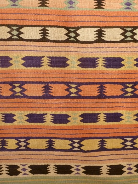 Rare and unusual Navajo Weaving.  Unusual geometric reminiscent of a Pendleton blanket in color and design.  Circa 1920's.  Finely woven.