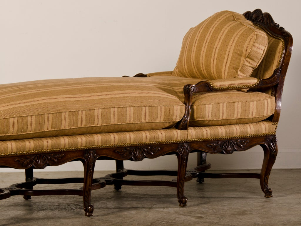 regence period carved walnut chaise longue france