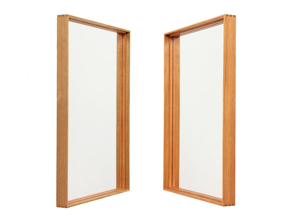 A thin edge oak mirror with box cut corners and leather mirror retainer. Can be hung horizontally or vertically. Oak and quartersawn pine.