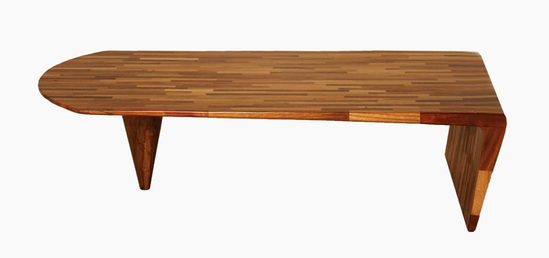 "Laminated patchwork bench from the ""Uai"" collection made from a variety of solid Brazilian exotic hardwoods and designed by Tunico T. Wood types include White Sucupira, Black Sucupira, Vinhatico, Peroba do Campo, Angico, Tamboril, Eucalipto"