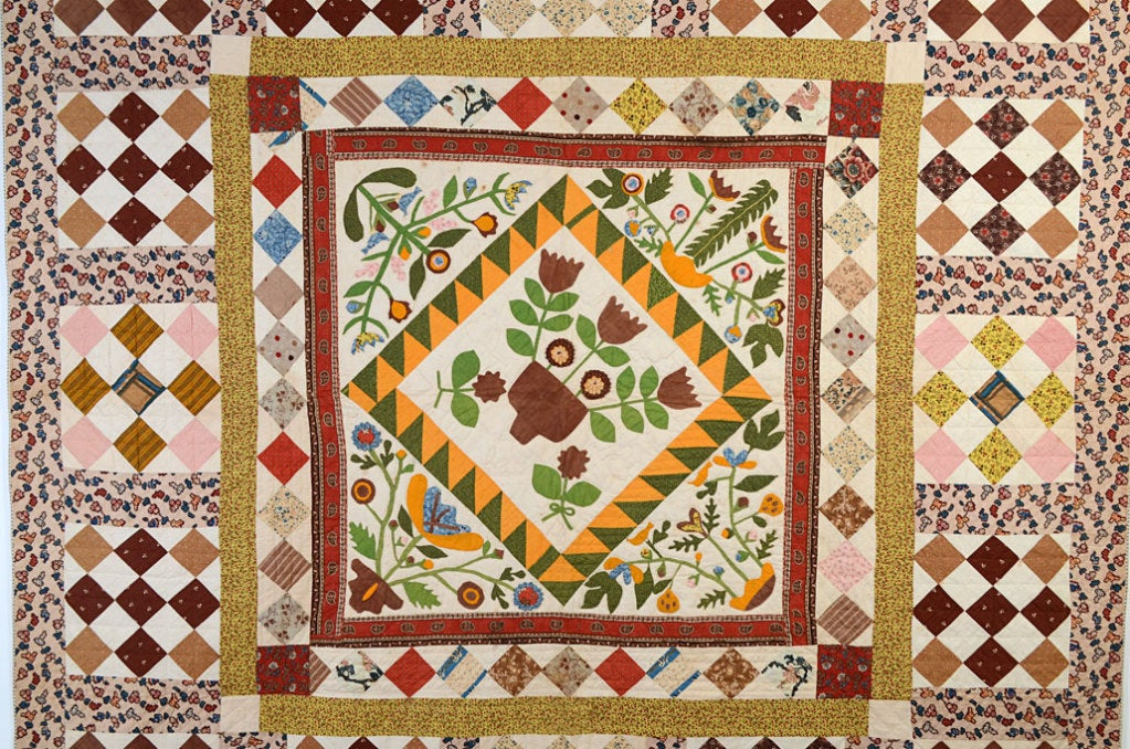 There seems to be no end to the creativity shown by 19th century quiltmakers. This original example is centered with a basket of flowers surrounded by additional pots with birds and a variety of flowers. Some of the flowers are three dimensional