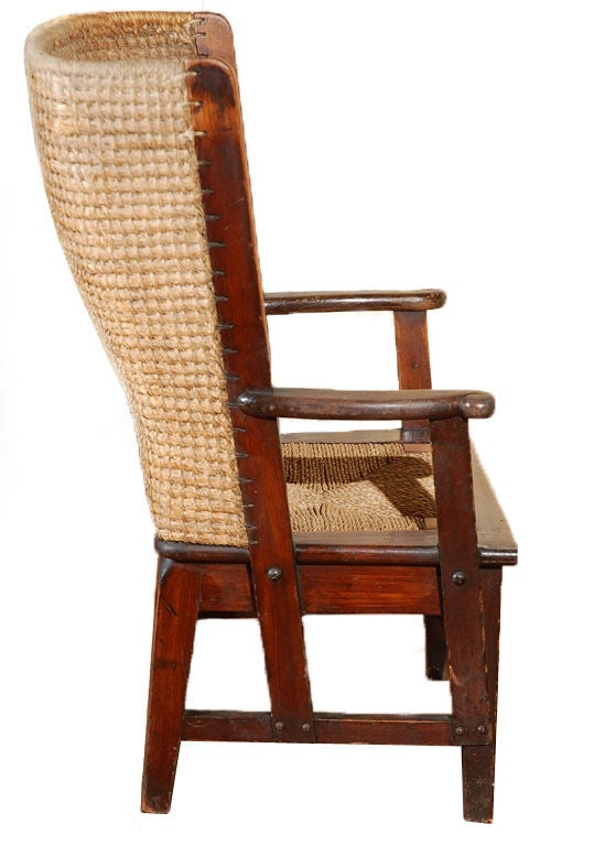 Mid-19th century American antique oak children's Fireplace chair with woven rush seat. This chair was most probably a salesman's sample or a custom version of this wingback gem.