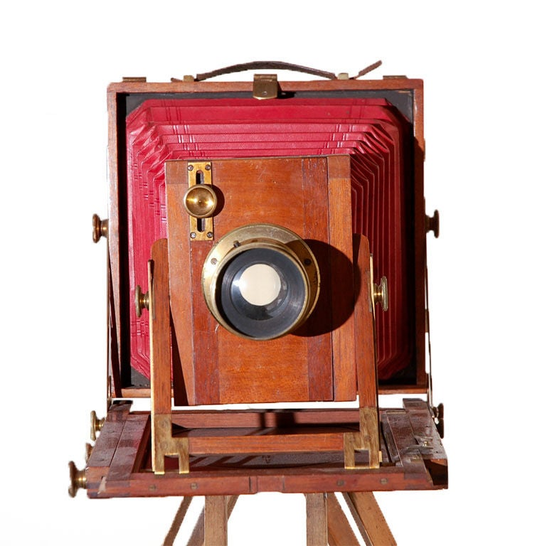 "This 19th Century wooden camera is known as a "" ReiseKamera"" or  travel camera. These cameras became popular in Europe in the late 1800s with a rise in the need for professional photographers looking for something smaller and lightweight to"