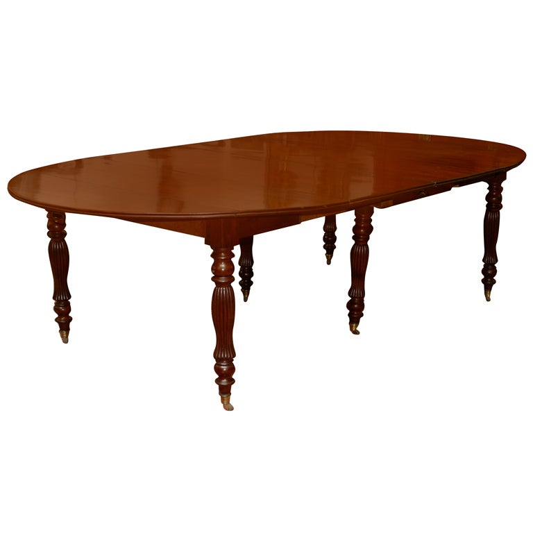 this 19th century french mahogany dining table with turned legs is no