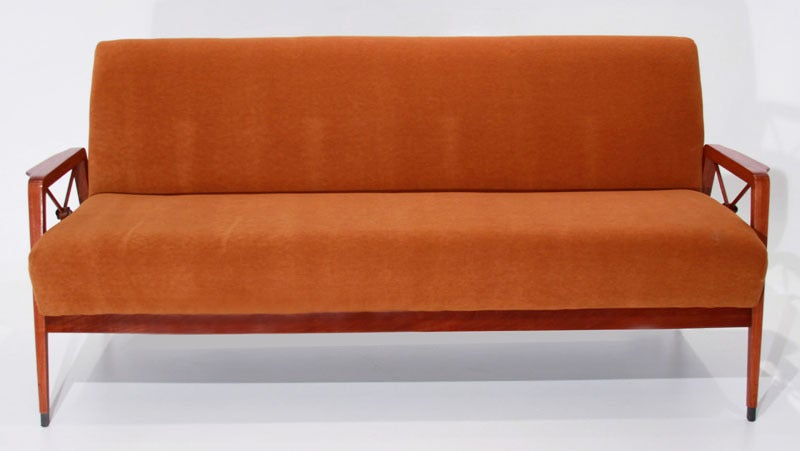Tangerine mohair and exotic wood frame sofa with bronze-tipped feet and bronze medallions designed for Cavallaro, Brazil. Seat depth 19.25""