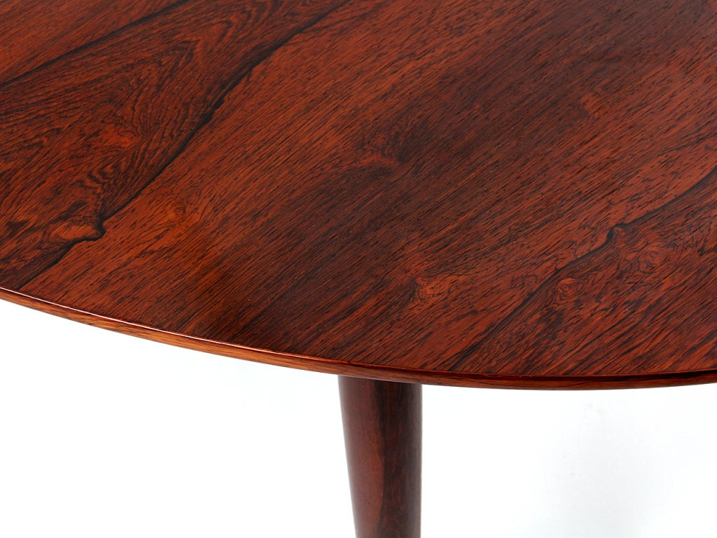 Mid-20th Century A Rosewood Dining Table by Finn Juhl For Sale