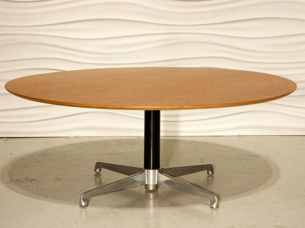 Danish Coffee Table Features A Teak Top And Aluminum Base The Table