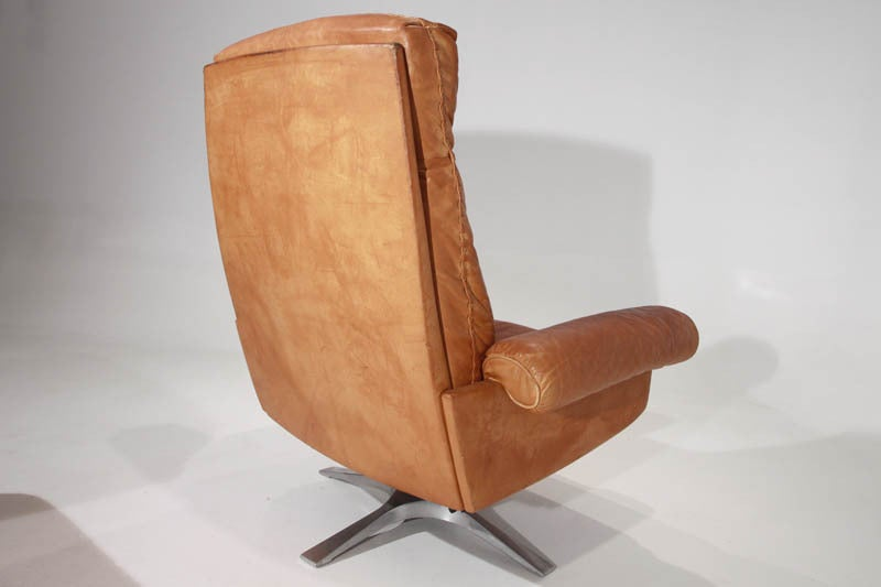 Swiveling Caramel Leather Armchair And Ottoman By De Sede