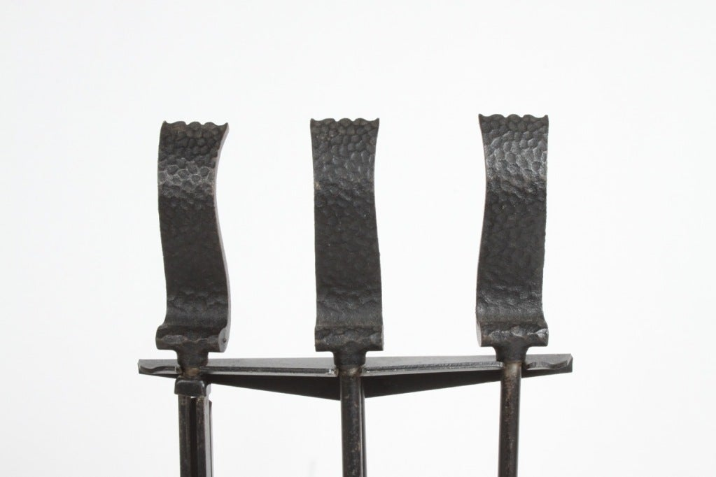 Scroll handles fire tools in textured iron, stand with tripod base, designed by Donald Deskey for Bennett, circa 1950.