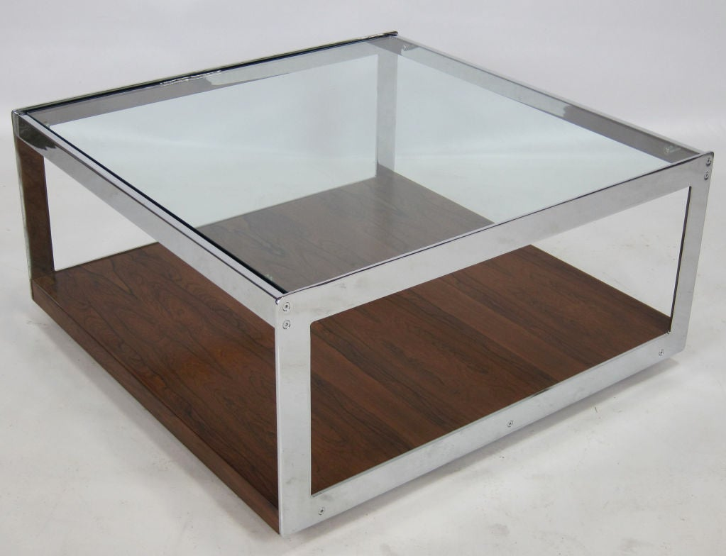 Rare Brazilian rosewood and chrome coffee table with inset glass top by Richard Young for Merrow Associates sold through Harrod's-London. Concealed casters. This design is very similar in feel and construction to the Knoll collection by Joseph