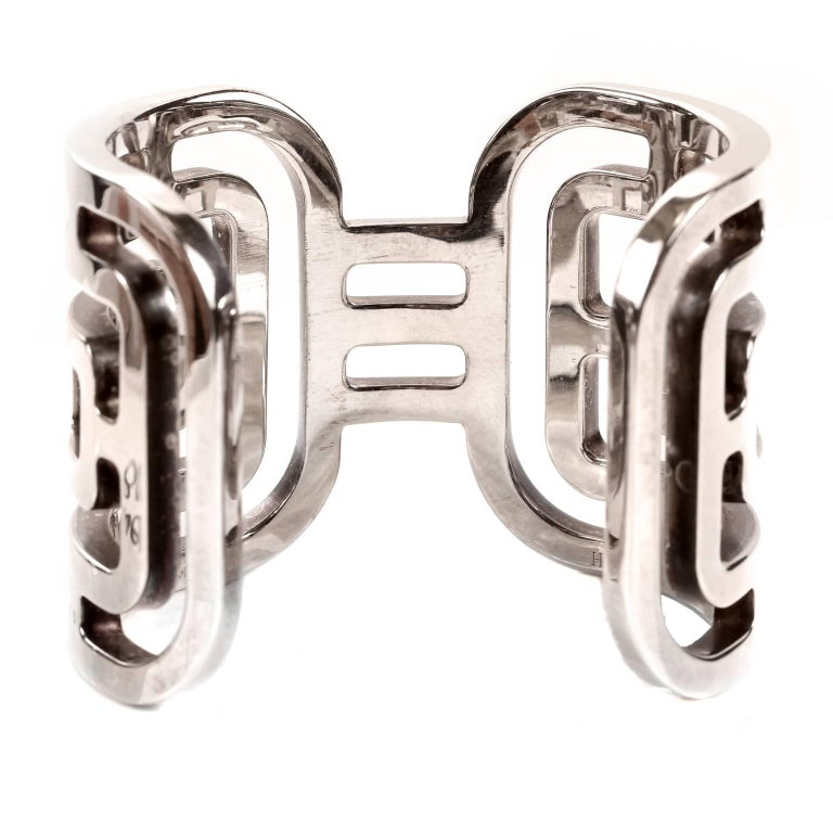 Hermès Sterling Silver Aztec Cuff Bracelet- MINT condition.  Wide silver cuff is substantial, yet elegant thanks to the open geometric Aztec inspired pattern.  Hermès pouch included. A251
