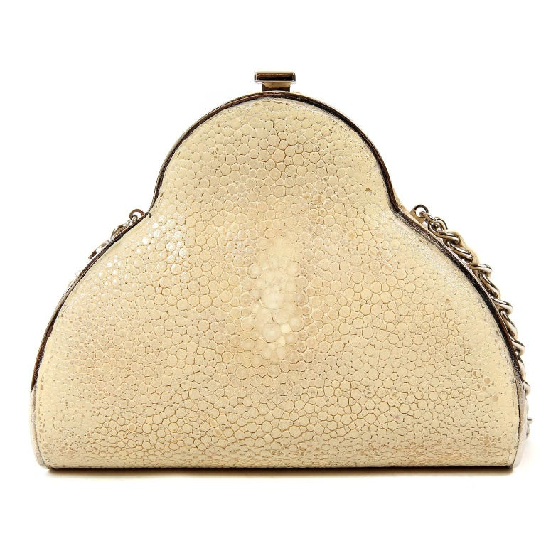 Chanel Beige Stingray Crossbody Evening Bag- Very Good Condition  Very Rare, this is a  structured evening bag in distinctive stingray with silver hardware accents.  Hinged opening with CC push lock clasp on the top.  Cream interior.  Extra long