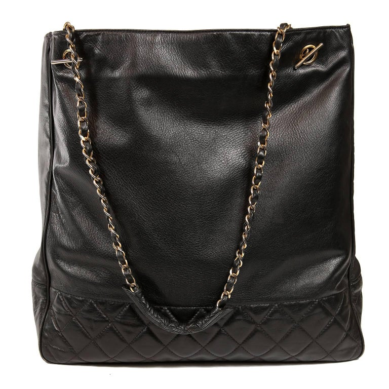 Chanel Black Leather Large Vintage Tote Bag- Excellent Condition Collectible vintage piece from the 1980's.    Black grainy leather tote has sturdy quilted bottom section.  Snap closure with extremely clean leather interior.  Double leather and