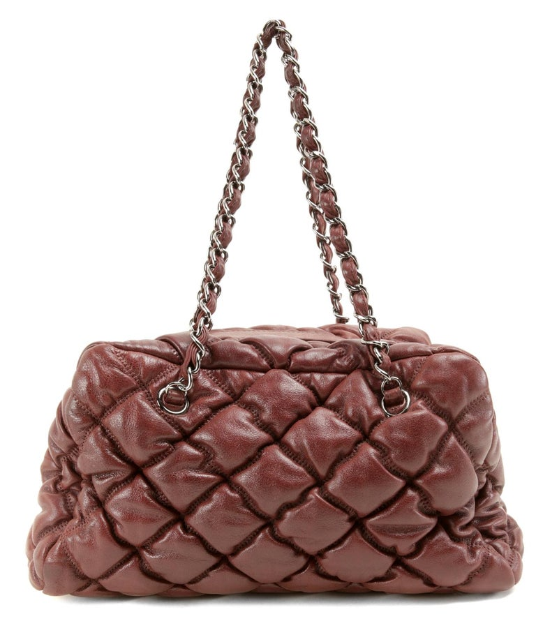 Chanel Wine Red Leather Bubble Bag- PRISTINE The striking color enhances the texture of the unique bubble quilting beautifully. Roomy but not unwieldy, this piece is perfect for every day enjoyment. Wine red leather is quilted in the extra puffy