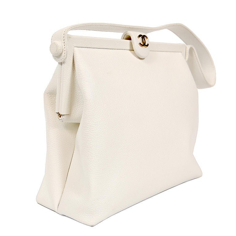 Chanel White Caviar Frame Top Bag- Excellent Vintage Condition   The leather is very clean(inside and out) and the hardware is gleaming.  A beautiful addition to any collection.   Snowy white caviar leather is textured and durable.  Framed top with