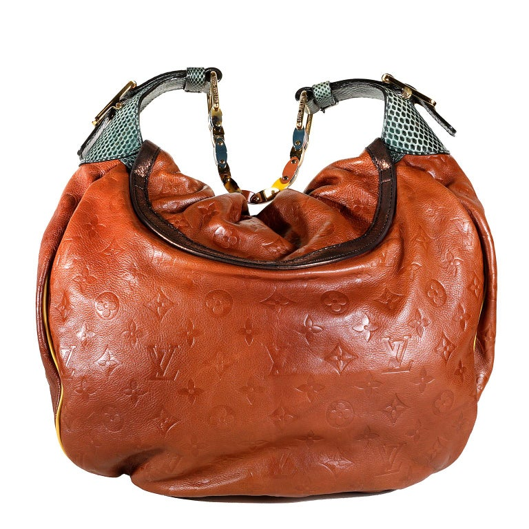 Louis Vuitton Paprika Monogram Leather Kalahari GM - NEW condition  From the Spring Summer 2009 Collection, this special edition of the Kalahari has some amazing design elements.   Rich Paprika calfskin is subtly imprinted with signature Louis