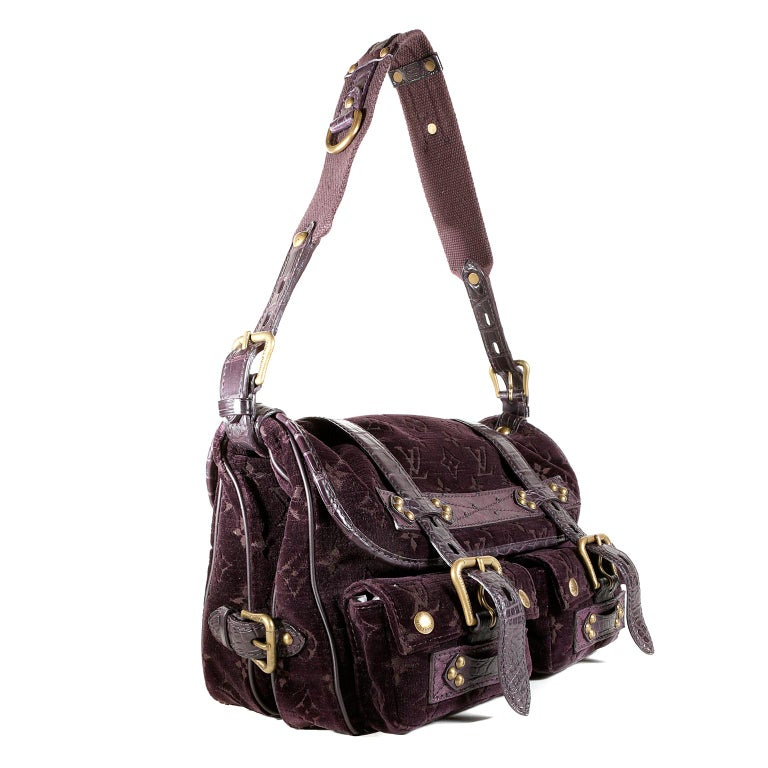 Louis Vuitton Eggplant Monogram Velours Clyde Bag- Pristine and Unworn From the 2004 Collection, it combines plush fabric with exotic accents.   Eggplant purple velour is subtly imprinted with signature Louis Vuitton monogram.  Alligator belts and