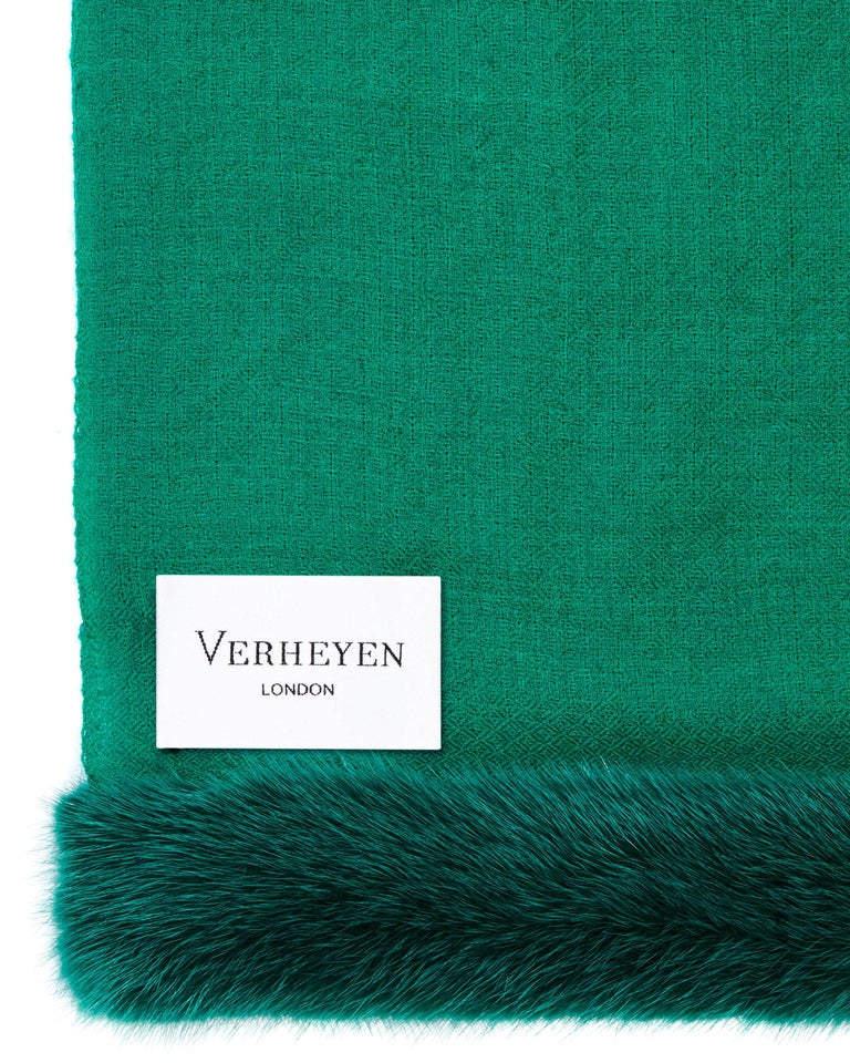 The perfect Christmas gift, Verheyen London's emerald green shawl is spun from the finest lightweight handwoven cashmere from Kashmir and finished with the most exquisite dyed mink. Its warmth envelopes you with luxury, perfect for travel and