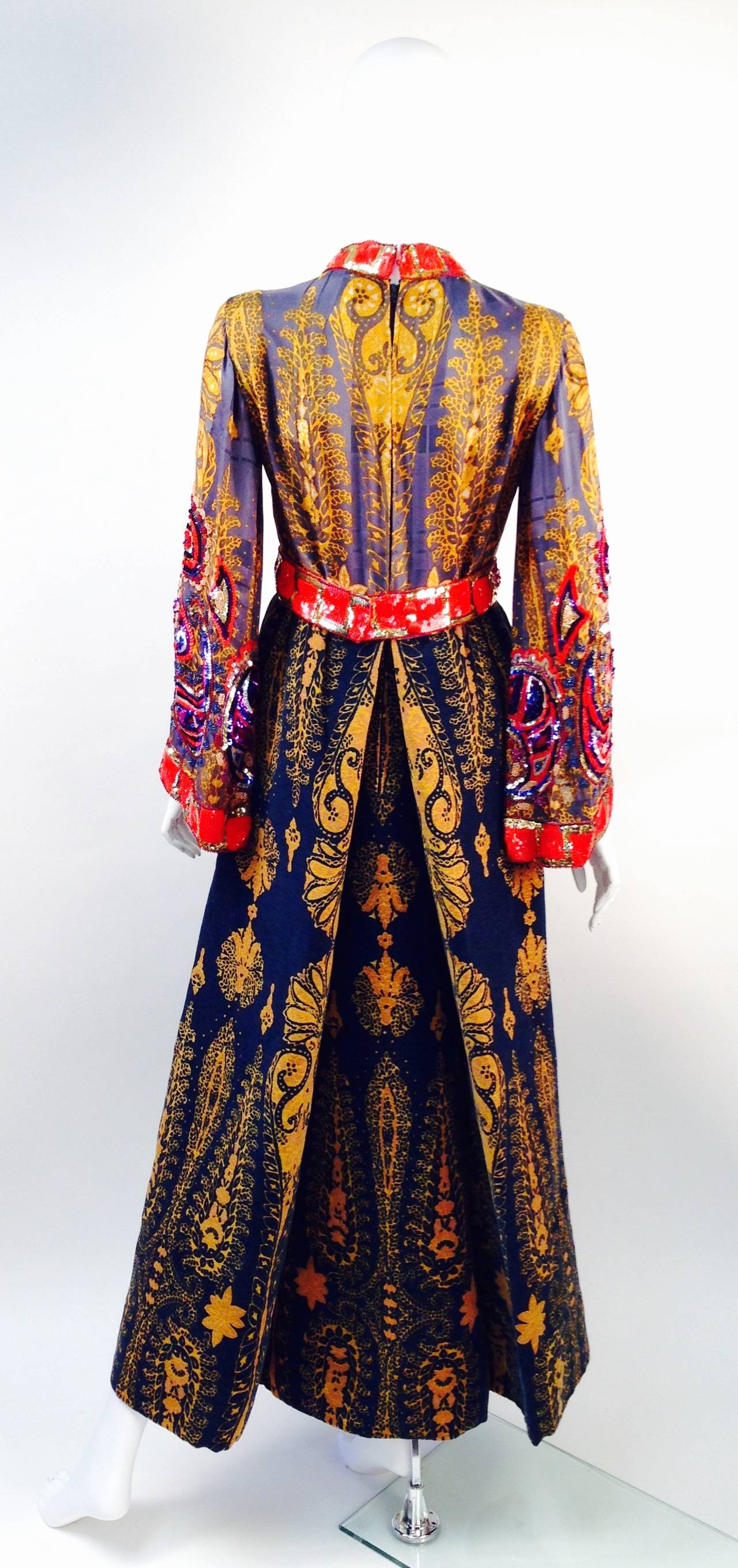A perfect trifecta of textile print design, textures, and simple shape -- uber creative Ronald Amey does it again with this unbelievable dress!!!  Somehow, this brilliant designer was able to create eccentric design, but never too much.  The gown