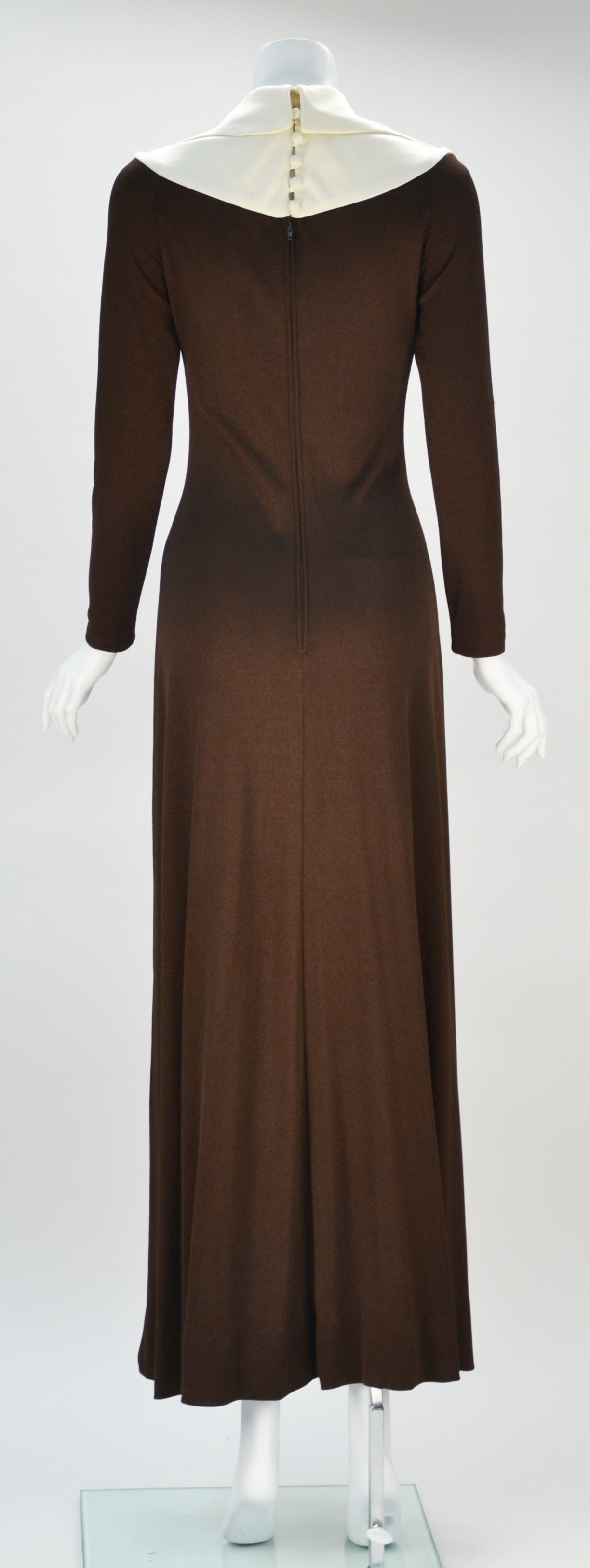 1970s Estévez Colorblock Hourglass Dress  Gorgeous 1970's chocolate brown and white colorblock floor length dress by Luis Estévez. This long sleeve, knitwear dress strikes a careful balance between alluring, playful, and austere. The dress flares