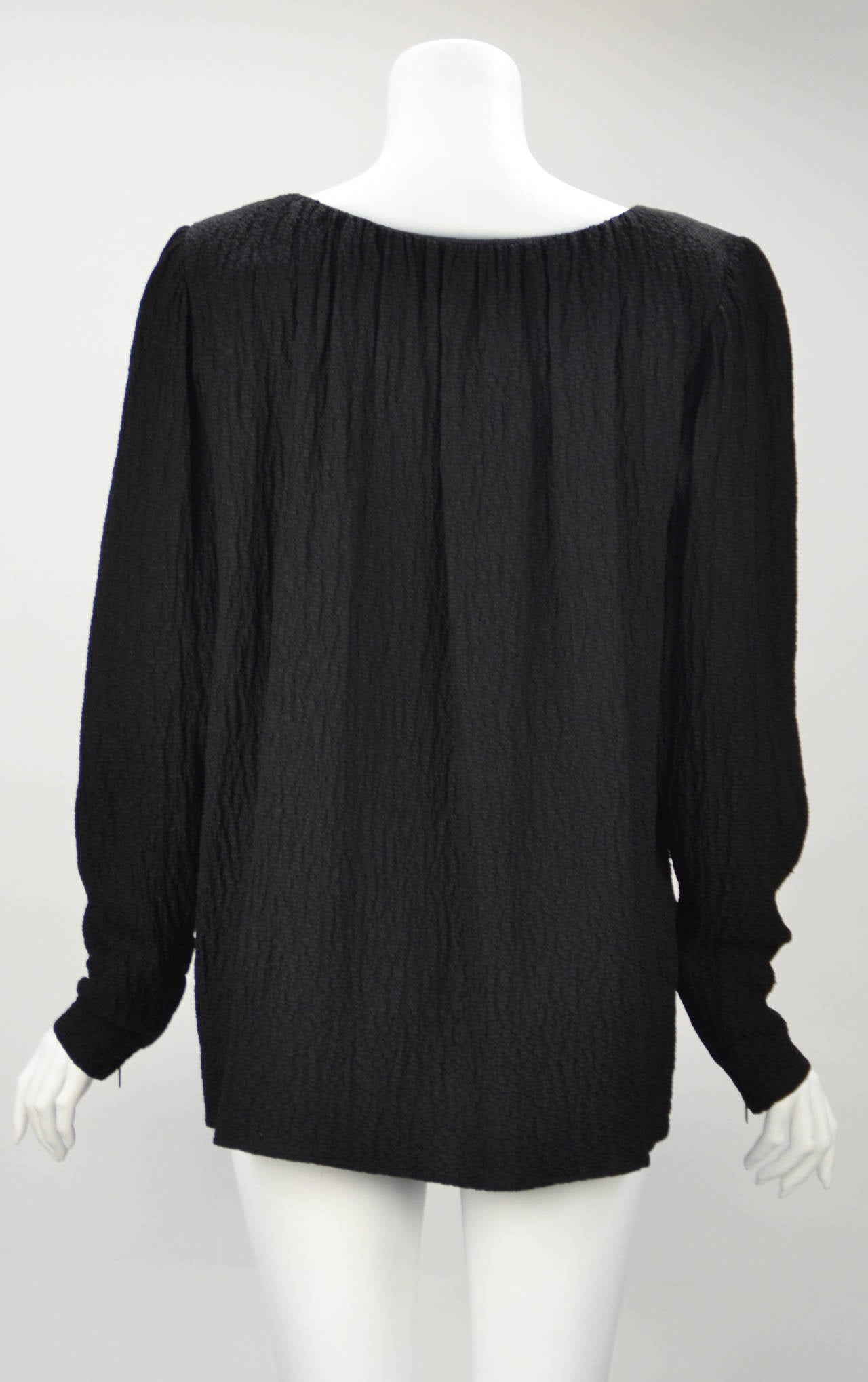 Timeless and beautiful, black crepe blouse with fitted zippered wrist at cuffs. Gathered neckline. Simply elegant and light weight.  Dress it up, dress it down... Wear it alone or under a vest, blazer or jacket....Winter, spring, summer, or fall...